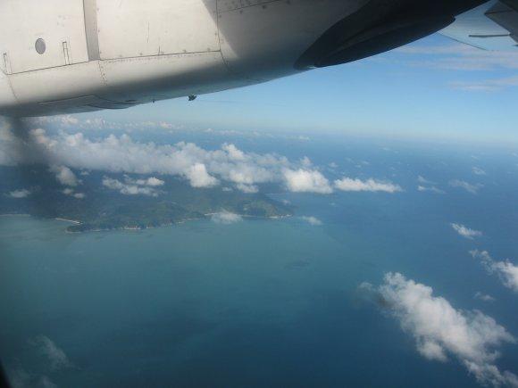 Flugzeug Aussicht Kueste Wolken kostenlose Bilder downloaden